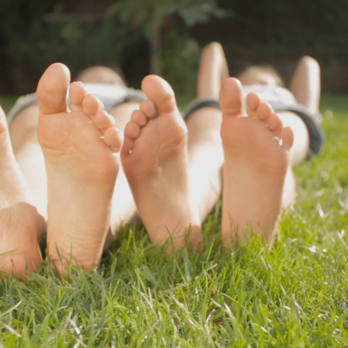 dolly-shot-of-two-girls-feet-relaxing-on-grass-at-sunny-day_hrga7xfp8l_thumbnail-full11